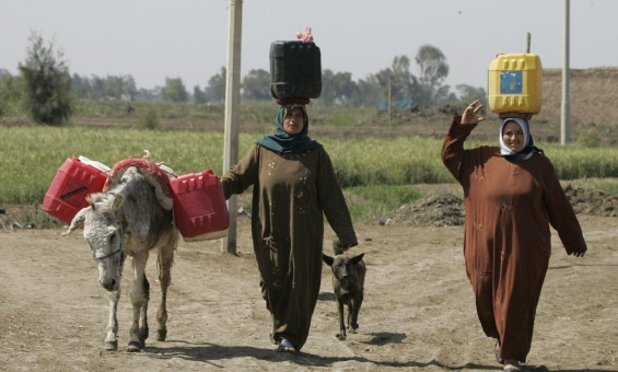 Egyptian's holding plastic barrels on his way to take water from pollution Canal at the Nile Delta town of Al-Borollos, 300 kms north of Cairo in March 16, 2008, during the 'UN World Water Day on 22 March'
