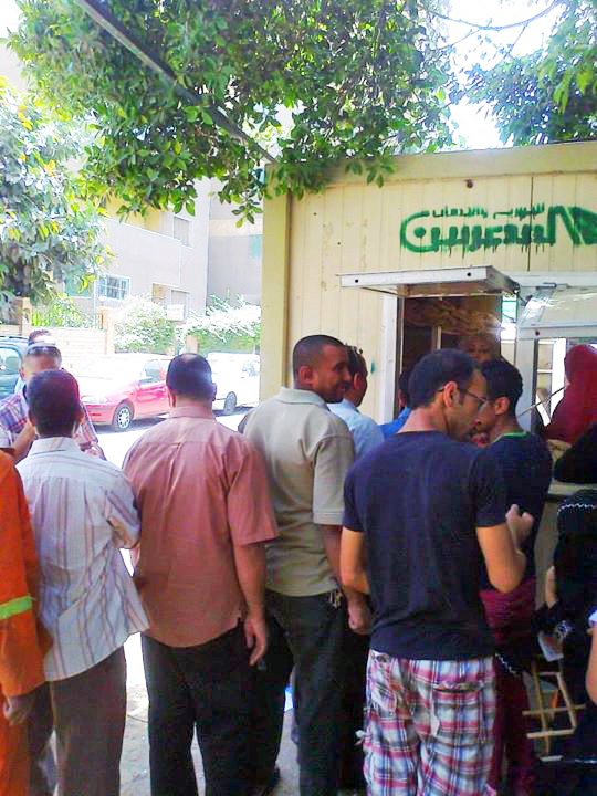 (source) Awlād 'Allām residents and members of the PCAA utilizing the opening of the new bread kiosk