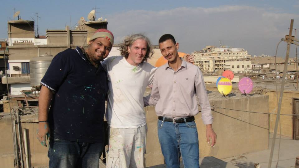 Stoneking and Other Volunteers at the Top of the Kodak Building (Source: Cairo Dish Painting Initiative Facebook page, 2014)
