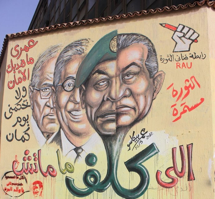 Painted on the wall surrounding the American University of Cairo on Muḥammad Maḥmūd Street in September 2011, this Graffiti by Omar Picasso Criticizes the Mandate (taklīf) Given to the SCAF – and Especially its President, Marshal Tantawi – to Rule the Country after President Mubarak resigned (Source: Dawyer, 2012).