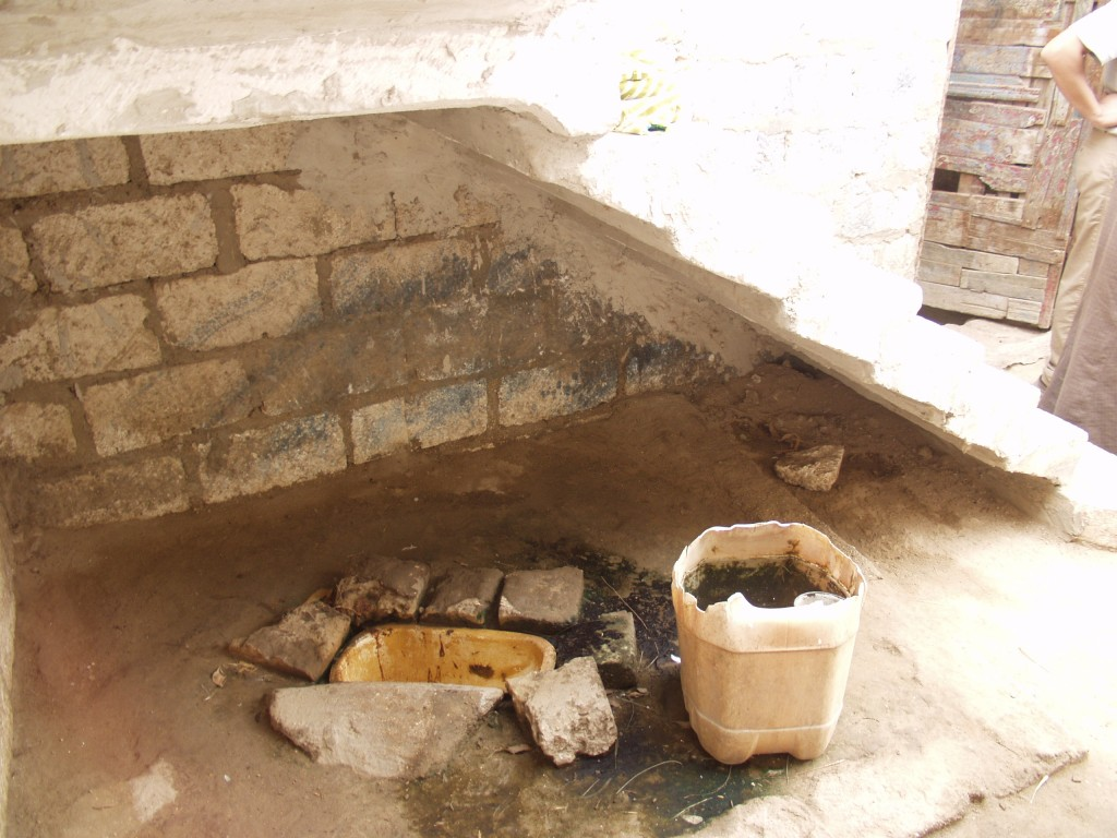 Poor households were and are still lacking humane sanitation – the photo is of an opening under the stairs used as toilet in one of the villages of Al-Maṭahra on the eastern bank of the Nile. (The Better Life Foundation 2006).