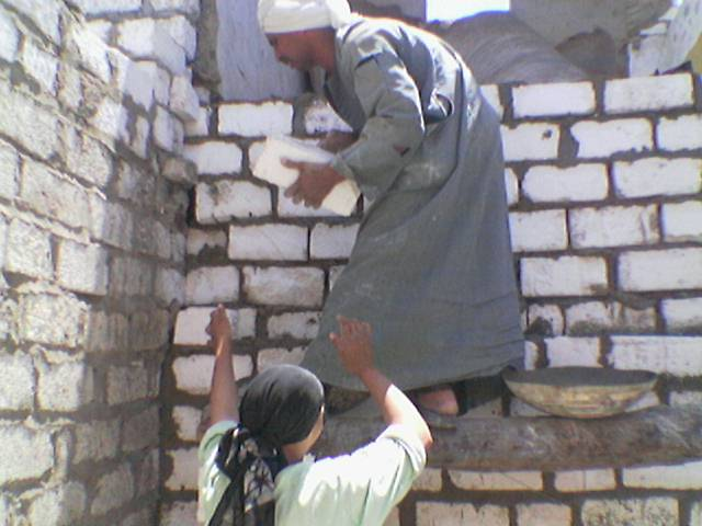 Members of the family constructing the new wall by themselves – source: The Better Life Association's Team