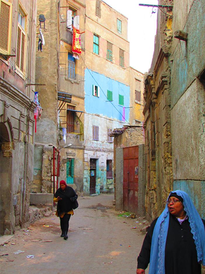 Al-Husayneyya Lane (ḥāra) in al-Khalīfa neighborhood. The photo shows examples of deteriorated old buildings. Source: Athar Lina Initiative. n.d.